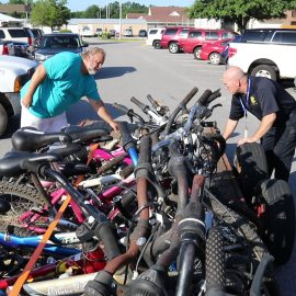 VIDEO: Sheriff's Department, church partner in peddling bikes to needy